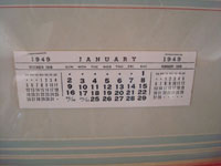 Photo of the 1949 calendar below the calendar-girl.