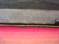Closeup photo of the text on the front of the Mexican vintage exvoto.