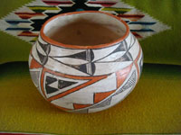 Native American Indian vintage pottery, an Acoma pot, c. 1960's. The pot is beautifully hand-painted with traditional Acoma geometric designs and is unsigned, indicating the age of the piece before artists began to regularly sign their pottery pieces. Another view of the Acoma pot.\