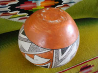 Native American Indian vintage pottery, an Acoma pot, c. 1960's. The pot is beautifully hand-painted with traditional Acoma geometric designs and is unsigned, indicating the age of the piece before artists began to regularly sign their pottery pieces. A photo showing the bottom of the Acoma pot.