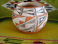 Native American Indian vintage pottery, an Acoma pot, c. 1960's. The pot is beautifully hand-painted with traditional Acoma geometric designs and is unsigned, indicating the age of the piece before artists began to regularly sign their pottery pieces.