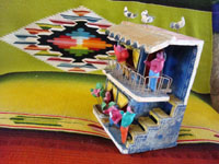 Mexican vintage folk art and Mexican vintage pottery and ceramics, a pottery 2-story apartment filled with Mexican tenants and with pigeons on the roof, by Candelario Medrano, Tlaquepaque, Jalisco, c. 1960. Photo of side of apartment.