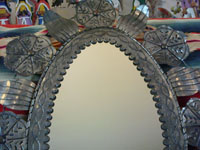 Mexican vintage tin-work, a closeup photo of the tin mirror.