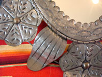 Mexican vintage tin-work, a second closeup photo of the tin-work mirror.