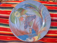 Mexican vintage pottery and folk-art, a beautiful burnished charger with a wonderful bird and floral design, blue background, Tonala, c. 1930's.  Main photo of charger.