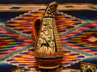 Mexican vintage pottery and ceramics, a beautiful petatillo (cross-hatching in the background, resembling a straw-mat or petate in Spanish) pulque pitcher, decorated with wonderful animals and foliage and with 6 finely decorated petatillo cups, Tlaquepaque, Jalisco, c. 1940's. Another view of the petatillo pottery pitcher.