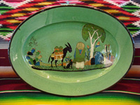 Mexican vintage pottery and ceramics, an oval platter with a pale-green background and very fine artwork, Tlaquepaque or Tonala, Jalisco, c. 1930's.  Main photo of the front of the platter.