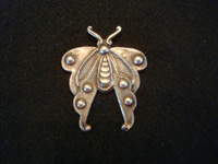 Mexican vintage sterling silver jewelry, and Taxco vintage silver jewelry, a sterling silver butterfly broach, Taxco, c. 1940's. The silver-work is bold and striking, and involves complex repousse. Main photo of the Taxco silver broach.