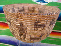 Native American Indian antique woven baskets and basket-weaving, a stunning Pima basket decorated with a figure of a man throwing a stick to his nineteen doggies, Pima, Arizona, c. 1915-20.  Closeup photo of the man throwing a stick on the side of the Pima basket.