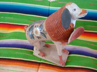 Mexican vintage folk art, and Mexican vintage pottery and ceramics, a whimsical pottery bank, in the shape of wonderful doggie, Tonala, Jalisco, c. 1950's. Main photo of the Tonala burnished pottery doggie bank.
