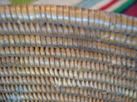 Native American Indian baskets, a fantastic Mission basket, very possibly Cahuilla, with a wonderful floral pattern, possibly Palm Springs or Santa Rosa Mountain area, c. 1920's. A closeup photo of a part of the California Mission Indian basket, showing the tightness of the fine weave.