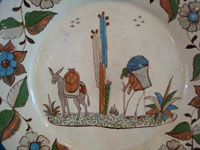 Mexican vintage pottery and ceramics, a beautiful, large pottery charger with wonderful artwork and a fine floral border, Tonala or San Pedro Tlaquepaque, Jalisco, c. 1930's.  Closeup photo of the artwork on the front of the Tonala or Tlaquepaque pottery charger.