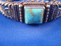 Native American Indian vintage silver jewelry, and Navajo vintage silver jewelry, a stunning silver bracelet with a very fine turquoise stone, Arizona or New Mexico, c. 1950's. Closeup photo of the turquoise stone on the Navajo silver jewelry bracelet.