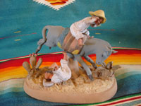Mexican vintage folk art, and Mexican vintage pottery and ceramics, a very fine clay sculpture of a bucking mule or horse and its terrified rider, most probably from the famous Panduro family of Guadalajara, c. 1930's. Another frontal view of the Panduro pottery sculpture.