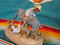 Mexican vintage folk art, and Mexican vintage pottery and ceramics, a very fine clay sculpture of a bucking mule or horse and its terrified rider, most probably from the famous Panduro family of Guadalajara, c. 1930's. Main photo of the Panduro pottery sculpture.