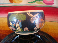 Mexican vintage pottery and ceramics, a set of 4 pottery cups and saucers, with a lovely blackware glazing and astounding artwork, San Pedro Tlaquepaque, Jalisco, c. 1930's. A closeup photo of a second cup with artwork depicting a Mexican village scene.