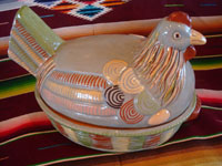 Mexican vintage pottery and ceramics, and Mexican vintage folk art, a lidded casserole in the form of a nesting hen with a rare teal-colored background glaze and wonderful colors, Tonala or San Pedro Tlaquepaque, Jalisco, c. 1940's. Main photo of the nesting hen.