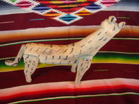 Mexican vintage folk art, and Mexican vintage woodcarving, a beautiful and very imaginative woodcarving of a jaguar, attributed to the great folk artist, Manuel Jimenez, from the village of Arazola, Oaxaca, c. 1950's. Another view of the woodcarving.