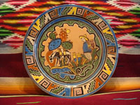 Mexican vintage pottery and ceramics, a beautiful plate with a wonderful Aztec-style border and crisp artwork, attributed to the famous Balbino Lucano, Tonala or Tlaquepaque, c. 1930's. Main photo of the Tonala plate.