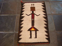 Native American Indian vintage textiles, and Navajo vintage rugs and textiles, a lovely pictorial Navajo rug or textile with a wonderful Navajo Yei figure as the central design, Arizona or New Mexico, c. 1940. Main photo of the Navajo Yei rug.