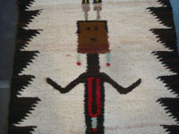 Native American Indian vintage textiles, and Navajo vintage rugs and textiles, a lovely pictorial Navajo rug or textile with a wonderful Navajo Yei figure as the central design, Arizona or New Mexico, c. 1940. Closeup photo of the Yei figure's face.