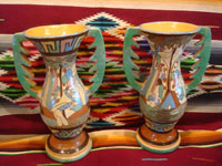 Mexican vintage pottery and ceramics, a pair of very lovely pottery vases with handles and beautiful, hand-painted decorations, Tonala or Tlaquepaque, c. 1940's. Another photo of the two vases, showing the second sides.