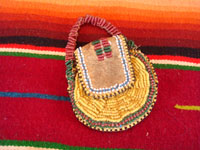"Native American Indian beaded pouch, Apache, c. 1850's. The pouch (probably a ""ration pouch"") has a wonderful handle and beaded flap. The beads are very small (including the ""whities"") and the beadwork is exquisite. Main photo of pouch."