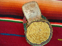 "Native American Indian beaded pouch, Apache, c. 1850's. The pouch (probably a ""ration pouch"") has a wonderful handle and beaded flap. The beads are very small (including the ""whities"") and the beadwork is exquisite. Photo shows inside of pouch with flap raised."