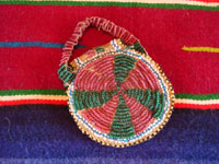 "Native American Indian beaded pouch, Apache, c. 1850's. The pouch (probably a ""ration pouch"") has a wonderful handle and beaded flap. The beads are very small (including the ""whities"") and the beadwork is exquisite. Photo of the back side of pouch."
