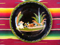 Mexican vintage pottery, a blackware plate from Tlaquepaque, Jalisco, c. 1930's. It features a very beautiful rural scene and a wonderful floral border. Main photo of plate.