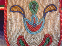 Native American Indian antique beadwork and folk art, a finely beaded belt-pouch, Cree, c. 1910-20. The beadwork is very fine and coloful, and condition is excellent given the age of the piece. Closeup photo of the fine beadwork.