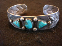 Native American Indian vintage sterling silver jewelry, a Navajo bracelet with beautiful Kingman, Arizona, turquoise and bump-out stamping, c. 1940's.