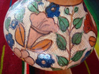 Mexican vintage pottery and ceramics, a beautiful petatillo pottery vase from Tonala, c. 1930's, attributed to the great artist Balbino Lucano. Closeup photo of the floral designs on the vase.