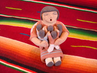 Native American Indian pottery and folk art, a story-teller from Jemez Pueblo with five children, signed B. Laretto, c. 1980. The grandmother's mouth is open, and the five children are obviously enthralled by her stories.