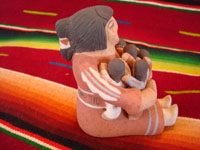 Native American Indian pottery and folk art, a story-teller from Jemez Pueblo with five children, signed B. Laretto, c. 1980. The grandmother's mouth is open, and the five children are obviously enthralled by her stories. A side-view of the story teller.