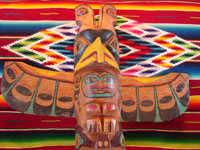 Native American Indian antique folk art, a wood-carved totem pole from the Pacific Northwest, Squamish, c. 1950. The totem pole features a wonderful eagle at the top, a transformation figure, and a beautiful bear. Photo of the top eagle.