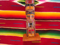 Native American Indian woodcarving and folk art, a lovely totem pole from the Pacific Northwest, c. 1940. The pole is carved from cedar and depicts an eagle and bear. Photo showing the figure near the bottom of the pole.