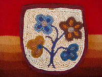 Native American Indian beadwork, a beautiful beaded pouch on native-tanned hide, Woodlands Indian, c. 1910-20. The beads are very fine, and the beadwork is exceptional! Main photo.