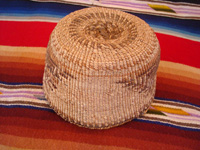 Native American Indian basket, a Klamath twined basket with the porcupine design on the sides, Klamath Indians of Northern California, c. 1910-20. Photo of the bottom of the Klamath Indian basket.