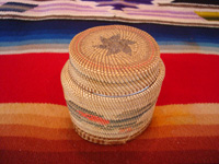 Native American Indian antique basket, a finely woven Northwest Coast basket, woven around a Pond's Cold Cream Jar and lid, Nootka or Makah Indians, c. 1920's. Photo showing the lid on top of the Northwest Coast Indian basket.