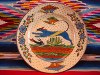 Mexican vintage pottery and ceramics, a very fine pottery plate featuring a leaping wolf, a blue bunny, butterflies and lovely foliage, with a starry-night background, from Tlaquepaque, Jalisco, c. 1920's. Main photo.