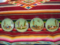 Mexican vintage pottery and ceramics, a set of four Tlaquepaque plates, all with beautiful pale-green backgrounds and exquisite artwork, Tonala or Tlaquepaque, Jalisco, c. 1920-30's. Main photo showing all four green Tonala or Tlaquepaque pottery plates.