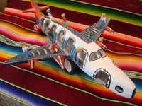 Mexican vintage folk art, and Mexican vintage pottery and ceramics, an amazing pottery jumbo jet with 13 very happy passengers, signed under one wing by the famous folk artist, Candelario Medrano, Santa Cruz de las Huertas, Jalisco, c. 1960's.  Main photo of the Medrano pottery airliner.