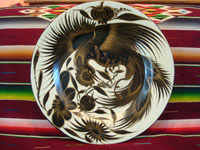 Mexican vintage pottery and ceramics, a large charger with excellent artwork, featuring a fantastic bird with outstretched wings, Tonala or Tlaquepaque, Jalisco, c. 1950's. Main photo of the Tonala charger.
