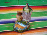 Mexican vintage folk art, and Mexican vintage pottery and ceramics, a lovely pottery figure of a Mexican woman with a large jar, Tlaquepaque or Tonala, Jalisco, c. 1940's. Main photo of the Tlaquepaque or Tonala pottery figure (ash tray).