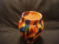 "Mexican vintage pottery and ceramics, a beautiful drip-ware (losa goteada) vase with vibrant colored glazes, Oaxaca, c. 1930's. This style of Oaxacan drip-ware pottery is commonly known as ""Mexican majolica"", and it is extremely beautiful! Photo shot from above the Oaxaca drip-ware vase looking down."