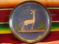 Mexican vintage pottery and ceramics, a lovely burnished plate with a beautiful blue background and wonderful artwork, Tonala or Tlaquepaque, Jalisco, c. 1930's. The artwork features a very graceful and elegant deer.  Main photo of the plate.