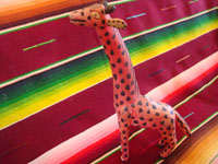 Mexican vintage folk art, and Mexican vintage wood-carvings, a darling woodcarving of a very fanciful and endearing giraffe, Oaxaca, c. 1950's. Main photo of the carved wooden giraffe from Oaxaca.
