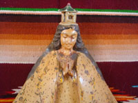 Mexican vintage devotional art, and Mexican vintage woodcarvings, a wonderful woodcarving depicting Our Lady of San Juan de los Lagos, by the noted carver, D. Cortez, c. 1930's. Closeup photo of Our Lady's serence face.