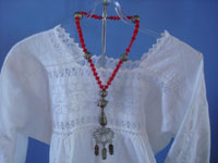 Mexican vintage sterling silver jewelry, and Purepecha (called Tarascans by Spanish conquerers) ceremonial sterling silver jewelry, a Purepecha necklace with silver and red glass beads, Michoacan, c. 1950.  Photo of the necklace worn over a lovely blouse on a manaquin.